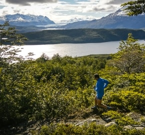 Ultra Trail Running in Ultima Esperanza, Patagonia, Chile; Ultra Fiord Route Fjord Running with Mountain Backdrop